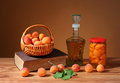 Fresh apricots and compote in a jar on the table Royalty Free Stock Photos
