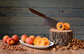 Fresh apricots pitted and stump on the table Royalty Free Stock Photos