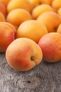 Fresh apricots on wooden background Royalty Free Stock Photography