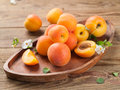 Fresh apricots on wooden plate selective focus Stock Photography