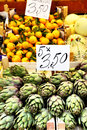 Fresh artichokes on counter at a market italy Stock Photo