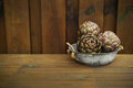 3 fresh artichokes green-purple flower head, on wooden backgroun Royalty Free Stock Photo