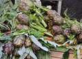 Fresh artichokes, traditional Italian street market Royalty Free Stock Photo