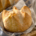 Fresh artisan bread baked in basket Royalty Free Stock Photos