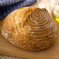 Fresh artisan bread baked on cutting board Stock Photo