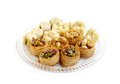 Fresh assorted traditional arabic sweets baklava is a sweet pastry made of layers of phyllo dough filled with chopped nuts and Stock Photos