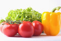 Fresh assorted vegetables bell pepper, tomato, garlic with leaf lettuce. Isolated on white background. Selective focus. Royalty Free Stock Photo