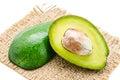 Fresh avocado fruits cit in half. Royalty Free Stock Photo