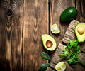 Fresh avocado with lime. On wooden background. Royalty Free Stock Photo