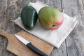 Fresh avocado and mango fruit on wooden table Royalty Free Stock Photo