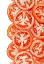 Fresh background with slices of tomato isolated Royalty Free Stock Photo