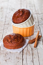 Fresh baked browny cakes and cinnamon sticks on rustic wooden table Royalty Free Stock Images