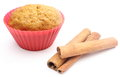Fresh baked carrot muffin and cinnamon stick. White background Stock Photography