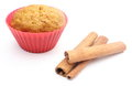 Fresh baked carrot muffin and cinnamon stick white background closeup of in red silicone cups stack of isolated on Stock Photography
