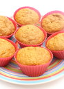 Fresh baked carrot muffins in red silicone cups Royalty Free Stock Photos