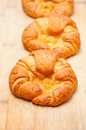 Fresh baked french croissant brioche on wood board Royalty Free Stock Photography