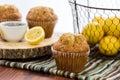 Fresh baked lemon poppyseed muffins adn lemons and poppyseeds Stock Photo