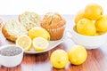 Fresh baked lemon poppyseed muffins adn lemons and poppyseeds Royalty Free Stock Images