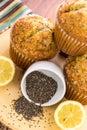 Fresh baked lemon poppyseed muffins adn lemons and poppyseeds Stock Photos