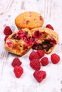 Fresh baked muffins with chocolate and raspberries on wooden background, delicious dessert Royalty Free Stock Photo