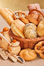 Fresh bakery products and ingredients in wicker basket various decoration Stock Photos