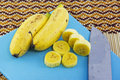 Fresh bananas on a cutting board with knife Royalty Free Stock Images