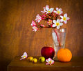 Fresh beautiful plumeria flower and many fruit on old wood table still life Royalty Free Stock Photos