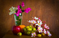 Fresh beautiful plumeria flower and many fruit paper on old wood table still life Stock Images