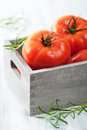 Fresh beef tomatoes in box wooden Stock Photos