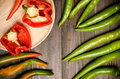 Fresh bell pepper and green pepper organic on wooden plate on black wooden background Royalty Free Stock Photos