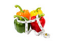 Fresh bell peppers all colors in measuring tape Royalty Free Stock Image