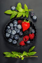 Fresh Berries On Dark  Backgro...