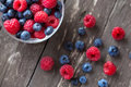 Fresh berries red raspberry, black blueberry Royalty Free Stock Photo