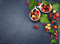 Fresh Berries on Slate Background (Strawberries, Raspberries and Royalty Free Stock Photo