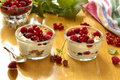 Fresh berries yogurt and granola parfait on a wooden table Stock Photography