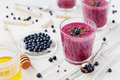 Fresh berry smoothie, milkshake, yogurt, dessert decorated grated chocolate, honey and blueberry