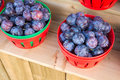 Fresh black Plums in baskets Royalty Free Stock Photo