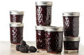 Fresh blackberry jam in jars homemade glass isolated on white Royalty Free Stock Images