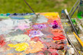 Fresh blended oil paint on a artist's palette Royalty Free Stock Photo
