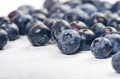 Fresh blueberries with mint on a wooden white table. Natural antioxidant. Concept of healthy food. Organic superfood Royalty Free Stock Photo