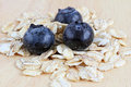 Fresh blueberries with oats on a wooden background Stock Photography