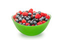 Fresh blueberries and raspberries in a green bowl on white background Royalty Free Stock Images