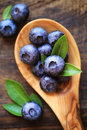 Fresh blueberries ripe in a wooden spoon Stock Image