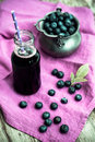 Fresh blueberries in zinc bowl, blueberry juice Royalty Free Stock Photo