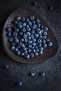 Fresh blueberry on black plate with water drops top view Royalty Free Stock Photos