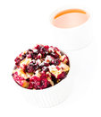 Fresh blueberry crumble dessert in a bowl with a cup of tea on tasty white background Stock Photography