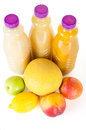 Fresh bottles of juice with fruits isolated on white and tasty bottle many Stock Images