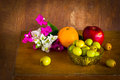 Fresh bougainvillea flower and fruit still life many kind of on old wood table Stock Images