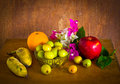Fresh bougainvillea flower and many fruit on old wood table still life Royalty Free Stock Images