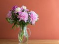 Fresh bouquet of peonies in a glass jug Royalty Free Stock Photos